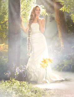 RAPUNZEL - AA $799 Asymmetric draped taffeta gown with twisted pick-up skirt, floral belt with pearls and crystals. Chapel Train Colors: Diamond White, White Also available with Lace-up back as style 214C  Shown with Veil 104L