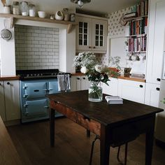 country kitchen, home, interior, dining table, subway tiles, cut flowers, range, aga, blue