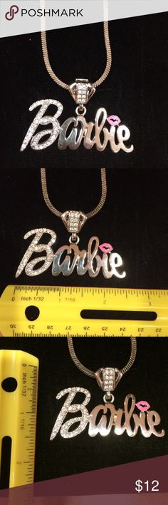 Barbie logo sequined lip necklace silver Barbie logo silver necklace with sequins and pink lips.  All sequins intact and in great condition. Worn 1x.  This is so sexy and stunning on, a must have! Barbie Jewelry Necklaces