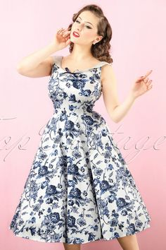 This 50s Maddison Toile Floral Swing Dress is one to fall in love with!With her round neckline at the front and back, elegant dark blue flower print and dark blue satin bow, she's truly a jewel to see. The fitted top and swing skirt ensures a feminine and flirty silhouette, oh la la! Made from a white cotton blend with a light stretch for a perfect and comfy fit. Put on your pumps, put in your earrings and give your Prince Charming a call, then we make sure you get this beauty in time ;-)...