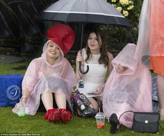 Let it rain: Racegoers braced against the downpour and donned ponchos over their racewear - topped with a fascinator - while they huddled under umbrellas drinking slurpees Melbourne Races, Melbourne Cup, Oaks Day, Wild Weather, Rain Poncho, Ladies Day, Fascinator, Derby, Harajuku