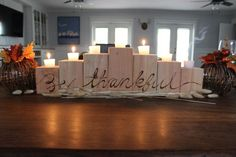 DIY Wooden Candle Holder Centerpiece that is perfect for Fall and Thanksgiving! on dreambookdesign.com