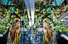 inside the mega fendi ginza store in tokyo, japanese artist azuma makoto has suspended a sculptural 'fur tree' from the ceiling of the pop-up boutique.