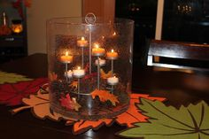Majestic Hearth Hurricane decorated for fall www.partylite.biz/nasparman