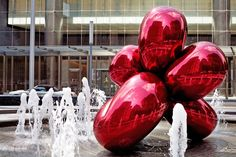 Balloon Flower (Red) by Jeff Koons, set in the shadow of the new World Trade Center in New York City.