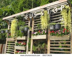 """To promote the """"farmer fresh"""" aspect as well as the greenhouse idea bus stops could be created that familiarize customers with what Lowes stands for. Bus Stop, Photo Library, Farmer, Lowes Food, Outdoor Structures, Concept, Stock Photos, Green, Image"""