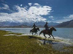 This picture was taking in the edge of Karakol Lake, Xinjiang. With background of Muztagata mountain in the morning. It was very hot morning day when i shot this lovely moment. I need to be precise to take the moment because i didn't know how long they were stayed there.  I shot with high speed to make i can shot it clearly and fast. I waited for the riders came closely to my camera range. It was a great shot for me.