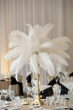 Lincolnshire Marriott Wedding Photos - Great Gatsby Theme! Creative wedding reception centerpiece ostrich feathers gold candleabras! Vale of Enna Floral design- Picture by Chicago Wedding Photographer - Nakai Photography http://www.nakaiphotography.com