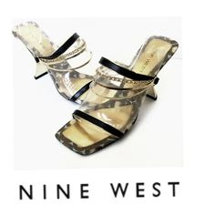 "NINE WEST Leather 'N-Ketty' Sandals with Chains Nine West N-Ketty will definitely have them saying ""I LOVE YOUR SHOES"" ~Sandals w/ double straps embossed black leather finished w/ gold edging~top strap has 3 goldtone chains that gracefully lay across the foot~a necklace for your feet ~gold lea footbed w/ animal print fabric trim designed to be exposed while wearing ~ spool heel in gold mirror finish ~Size:7.5~ pre-owned in great cond. note: heel has a few knicks ~nature of the…"