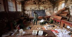 A Congolese rebel fighter walks through an abandoned classroom, which was used as an armory for Congolese army, in Bunagana. Human Rights Organizations, Safe Schools, Human Rights Watch, Armed Conflict, Congo, Student, Cool Stuff, Rebel, Abandoned