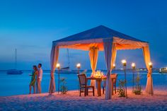 Pampered in Paradise offers incomparable romantic with the sea at your feet, tiki torches creating a glow on the sand and a private butler to see your every need.