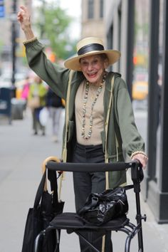 """ADVANCED STYLE: Spirited Style: I met this gorgeous woman while photo hunting near Madison Avenue. After snapping a quick portrait, she flung her hand in the air and said, """"That was fun. Let's try it again."""" I only spent a few quick moments with this wonderful lady, but it was a joy to see how much spirit she shared with me."""