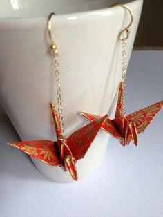 Origami crane earrings in red and gold featuring gold filled chain and ear wires