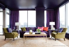A rich shade of purple is the signature of this chic condominium, wrapping not only the walls and ceiling but jumping onto the d