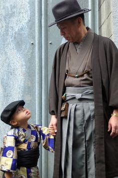 Japanese man and boy - I wonder what the story is here...the entire conversation looks to be in their eyes.