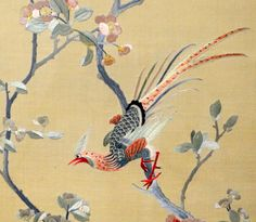 Two 19th century Chinese silk embroideries of birds amidst flowers and foliage
