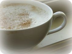 White and frothy with a slight sprinkle of cinnamon