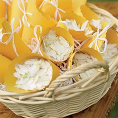 Brides.com: Backyard Garden Party. TossesHe loves you. He loves you—a lot. To make holders for daisy petals, cut edges of a rectangular sheet of paper with scalloped scissors, roll into a cone, and secure with double-sided tape. Punch holes, lace with white raffia, then fill with petals. Marigold paper sheets, Rossler at Kate's Paperie, katespaperie.com. Handled wicker basket, Bill's Flower Market, billsflowermarket.com.