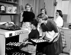 Women baking and eating cookies, Minneapolis,1954  - and the aprons!