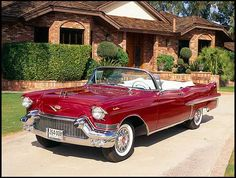 1957 Cadillac DeVille Convertible (that red just makes you want to lick it like a lollipop!)