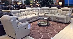 You and your loved ones will cherish the quality time you're able to spend relaxing together in this beautiful leather sectional with a built in recliner! | Houston TX | Gallery Furniture |