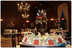 Aqua blue and orange wedding reception with bright table runner and menu details | villasiena.cc