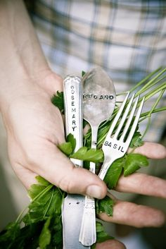 label the end of silverware and bury in soil along side plants