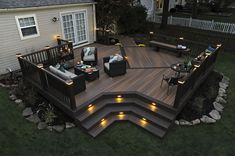 what a nice and cozy terrace ! love the lights and wooden floor..