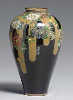 A Small Cloisonné Enamel Vase Meiji period (circa 1900), signed Kyoto Namikawa [workshop of Namikawa Yasuyuki, 1845-1927] Of meiping form and worked in silver wire and polychrome enamels with chrysanthemums scattered over drips of simulated brown glaze around the shoulders, the edges of the glaze drips rendered with double silver wires and a thin line of darker brown enamel; signature on a square silver tablet mounted on base 3¾in. (9.5cm.) high