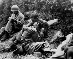 A grief-stricken American infantryman whose buddy had just been killed is comforted by a fellow comrade (1950), Korea