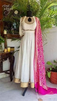 Off white mulmul anarkali with zardozi embroidery around the neckline and sleeves, teamed with a blue banarasi pure silk handloom dupatta, and a rani pink pure georgette banarasi zari dupatta with rai bandhani. Indian Fashion Dresses, Dress Indian Style, Indian Gowns, Indian Designer Outfits, Indian Attire, Pakistani Dresses, Indian Outfits, Designer Dresses, Indian Wear