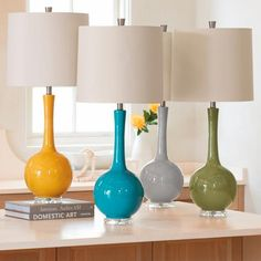 Super-clean, glossily well-colored, and gently modern, our Olivia Table Lamp is one of the easiest pieces to bring into your home. Should we call it our    super-lamp? It goes with every kind of d, and offers a simple, graceful form that enhances a room without overtaking the space. This style offers    a nice height for useful ambient lighting, too. And the color of the base is fresh in tone. This ceramic style comes with a cotton