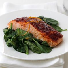 A sweet-smoky rub featuring smoked paprika, brown sugar and cinnamon complements salmon's moderate flavor and moist meaty texture. Served on a bed of sautéed spinach, this dish makes a lovely presentation for entertaining.