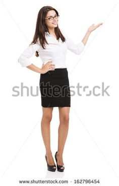 Beautiful hispanic business woman smiling over a white background presenting something - stock photo