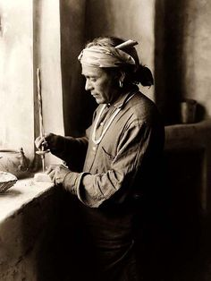 Here for your perusal is an original photograph of a Zuni Bead Worker Drilling Holes. It was created in 1903 by Edward S. Curtis.    The photograph illustrates the traditional Zuni craft of making beads and jewelry.    We have compiled this collection of photographs mainly to serve as a valuable educational resource. Contact curator@old-picture.com.    Image ID# E8AE99D5