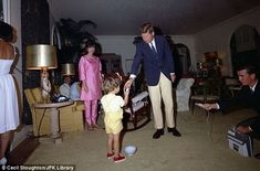 Easter Sunday in Palm Beach: President Kennedy hands an Easter Egg to John F. Kennedy, Jr. while First Lady Jacqueline Kennedy looks on.  (Palm beach, Florida)