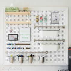 Tutorial for making your own customized pegboard wall organization unit. Store craft supplies while keeping your DIY office pretty and functional.