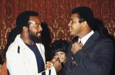 Former NFL superstar Jim Brown greets heavyweight boxer Muhammad Ali at an event in New York New York in November 1971 Four years earlier in the wake...