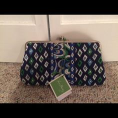 Vera Bradley Clutch Wallet 2 section clutch - section 1: six credit card slots and zipper pouch; section 2: ID slot; slot for dollar billstrades Vera Bradley Bags Clutches & Wristlets