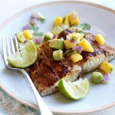 It doesn't matter if you grill the fish outdoors or in a stovetop pan, the result will be a delectably moist mahi mahi served with a piquant salsa of mango, avocado and red onion in lime juice. #fish
