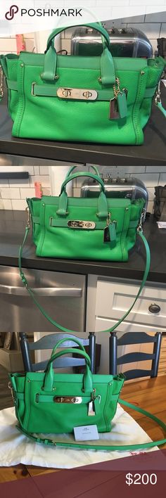 Large Coach Swagger Purse Stunning large coach Swagger bag. Beautifully kept in dust bag in smoke free home. Carried twice since purchase....no pen marks, scuffs or blemishes on this almost brand new piece.  Make me an offer I can't refuse! Coach Bags Satchels