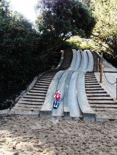 Cement slides in the Koret Children's Center in Golden Gate Park.  Kids use cardboard to slide down.  photo2