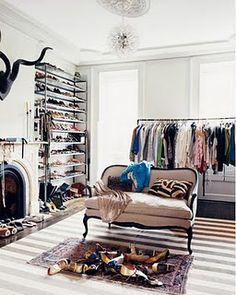 looks like a room converted into a walk in closet or dressing room love this idea.