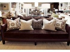 dark brown couches need color pillows | BROWN COUCH: Another solid idea as a canvas for pillow decor.