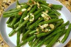 Rosemary Lemon Green Beans with Toasted Almond  Beans can't be more better in taste and simpler to cook!! These Rosemary Lemon Green Beans with Toasted Almond are just superb! Crispy beans flavored with herby butter and almonds will be thoroughly enjoyed by all your friends and family at any dinner party!!