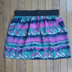Like New Printed Skirt with Back Zipper Detail Multi color printed skirt with black elastic band waist and zipper detail in back. Has two pockets which is a plus! Purchased from Boutique. Size small. I'm a 0 and this fits big on me which is I am selling! Wore once. Boutique Skirts