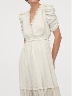 This beautiful ivory dress features a sweet ruched sleeve, ruffled neckline and tiered skirt, all the romantic elements in one beautiful dress. It's available in the client wardrobe in a size medium. Ivory Dresses, Beautiful Dresses, Neckline, Romantic, Summer Dresses, Studio, Medium, Skirts, Sleeves