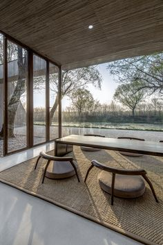 Low wood chairs at Waterside Buddhist Shrine by Archstudio | Photo by Wang Ning, Jin Weiqi.