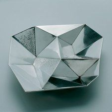 Hopeakeskus. Compartmentalized dish designed by Tapio Wirkkala. / How fun would it be to eat rice, side dishes and chutneys from this?
