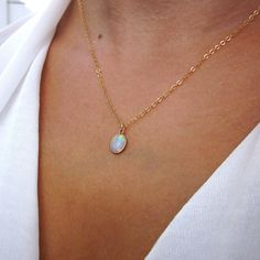 Genuine rainbow Opal necklace  A Simple yet stunning, genuine Ethiopian Oval Opal set in a 14k Gold filled bezel hanging from a sparkeling 14k Gold Filled Chain. This gorgeous pendant necklace is simple, elegant and comfortable for all day wear. I always get compliments on mine :-)  One of the pictures is shown upclose and in direct sunlight to show the true colors these beautiful Fire Opals have, also shown with 5 x 7s and 6 x 8s.  ♥ Opal Gemstone options: - 5 x 7 mm - 6 x 8 mm ♥♥ Pictured…